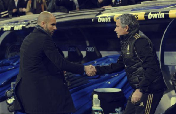 "Barcelona's coach Josep Guardiola (L) and Real Madrid's coach Jose Mourinho shake hand before the Spanish Cup ""El clasico"" football match Real Madrid vs Barcelona at the Santiago Bernabeu stadium in Madrid on January 18, 2011. (Photo via DANI POZO/AFP/Getty Images)"