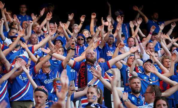 Iceland fans follow through with their traditional hand clap after the game against England. (Photo by Alex Livesey/Getty Images)