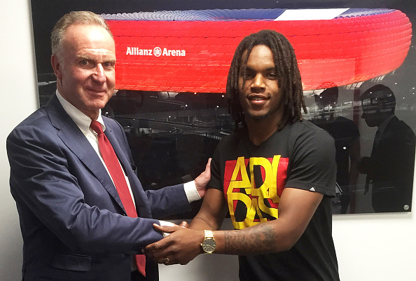 MUNICH, GERMANY - MAY 10: Renato Sanches (R) and CEO Karl-Heinz Rummenigge of Bayern Muenchen pose for a photo after signing a contract at Bayern's training ground Saebener Strasse on May 10, 2016 in Munich, Germany. (Photo by Getty Images for FC Bayern)