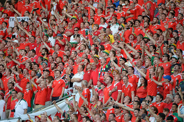 Welsh fans were singing in full voice at the end of the game despite their team losing out, a show of their appreciation for the effort put out there by their fellow countrymen.  (Photo by Bob Thomas/Popperfoto/Getty Images)