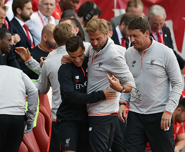 Jurgen Klopp lost his glasses aplenty during the game, but here he loses it while congratulating Coutinho. (Photo by Andrew Powell/Liverpool FC via Getty Images)