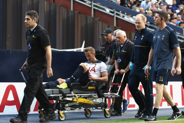 Harry Kane left the stadium on a stretcher, much to the displeasure of the home fans. (Photo by Julian Finney/Getty Images)
