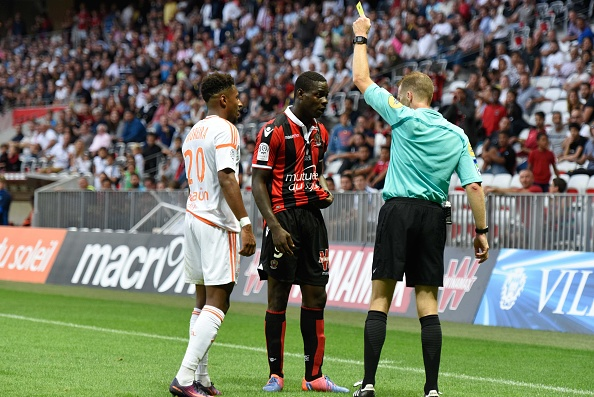 Mario receives a second yellow card for fouling Steven Moreira. Typical. (Photo via Agence Nice Presse/Getty Images)