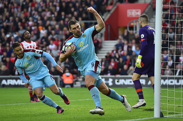 Sam Vokes converts Burnley's penalty. (Photo by Glyn Kirk/AFP/Getty Images)