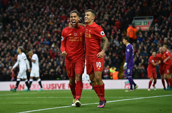 Firmino celebrates scoring with his compatriot. Are these two Brazilians less pivotal to Liverpool's success than Sadio Mané? (Photo by John Powell/Liverpool FC via Getty Images)