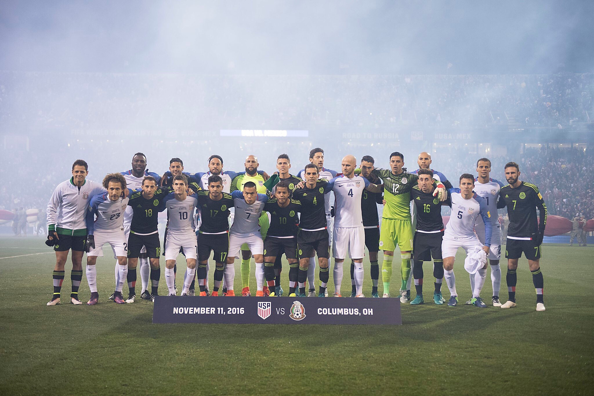 The players stand in unison before the match—in light of Trump's election? (Photo via  imgur )