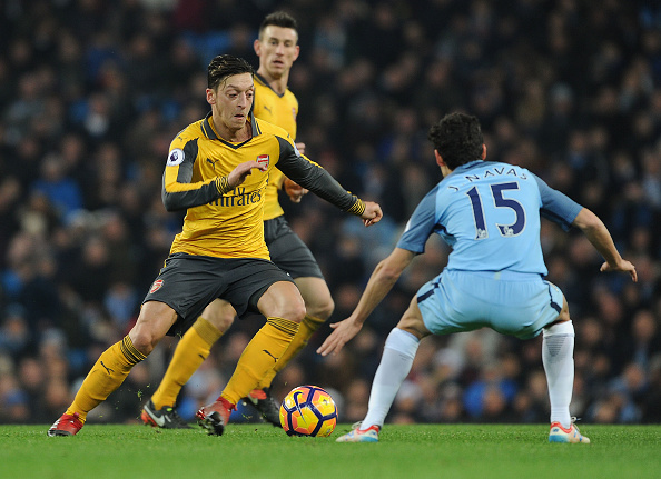 Ozil takes on Navas (!) during the game against City. Hey, it shows that he moved! (Photo by Stuart MacFarlane/Arsenal FC via Getty Images)