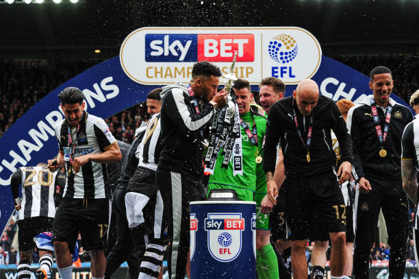 Newcastle players celebrate their title win. (Photo by Stu Forster/Getty Images)