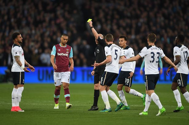 Referee Anthony Taylor had an interesting take on the Laws of the Game Friday night, a fact not lost on the Spurs players. (PHOTO CREDIT: Mike Hewitt/Getty Images)