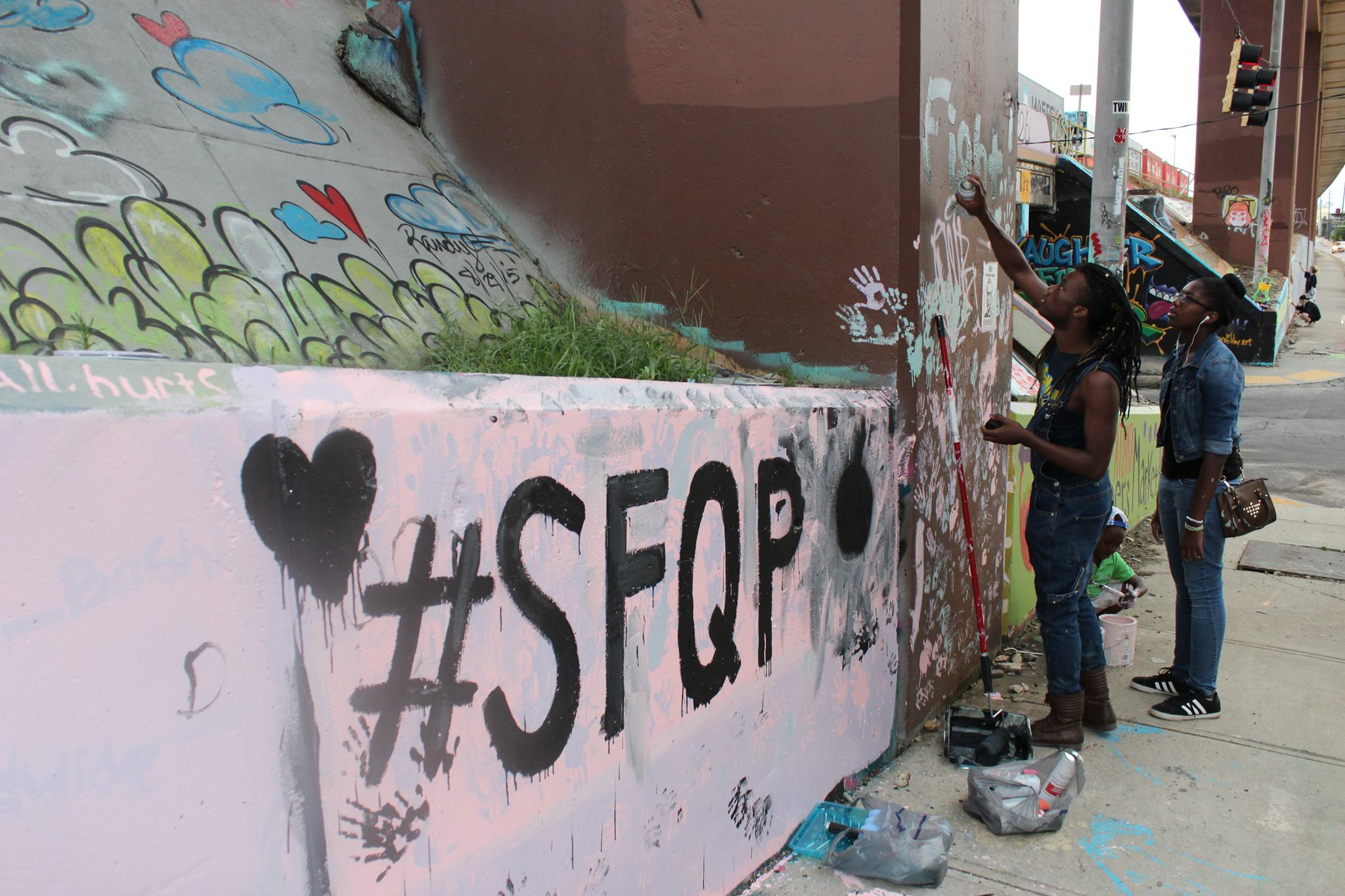 SFQP organizers painting Atlanta local Krog Street Tunnel to promote our 2016 Atlanta festival.