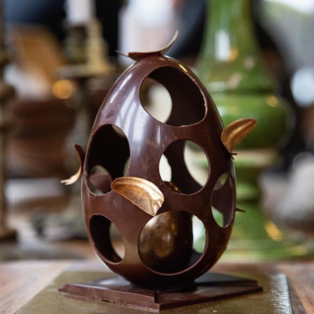 The Feather Egg | dark chocolate shell revealing a solid gold, salted caramel bonbon egg. Don't be boring this Easter...Be fancy! Come in or order now.  #milse #eastereggs #hipgrouplife