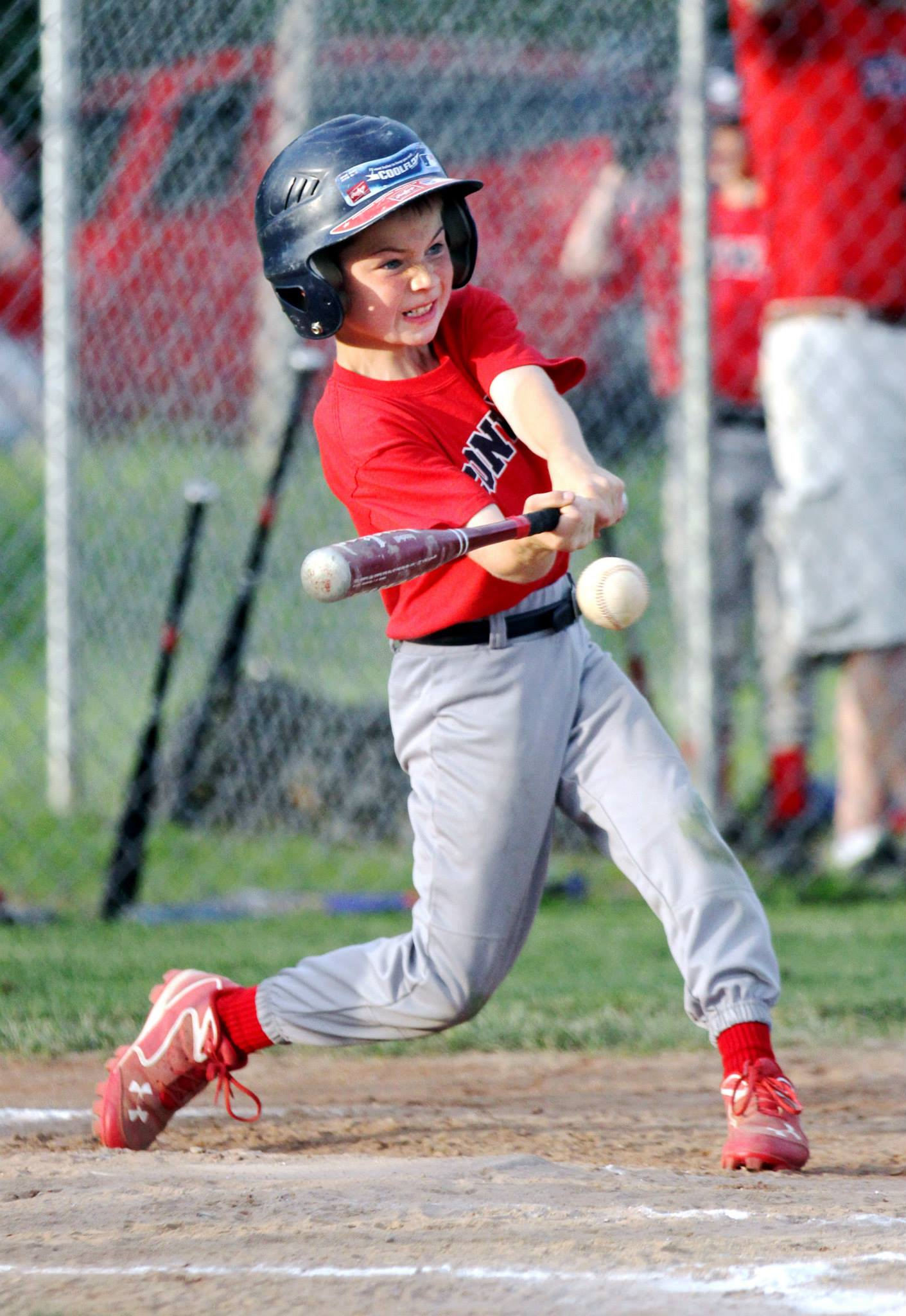 CONWAY, MASS. --Shane Prusak, 8, takes a swing during the youth league Conway Cobra v. Royal LLP game at Herlihy Park on Monday. (Recorder/Micky Bedell)
