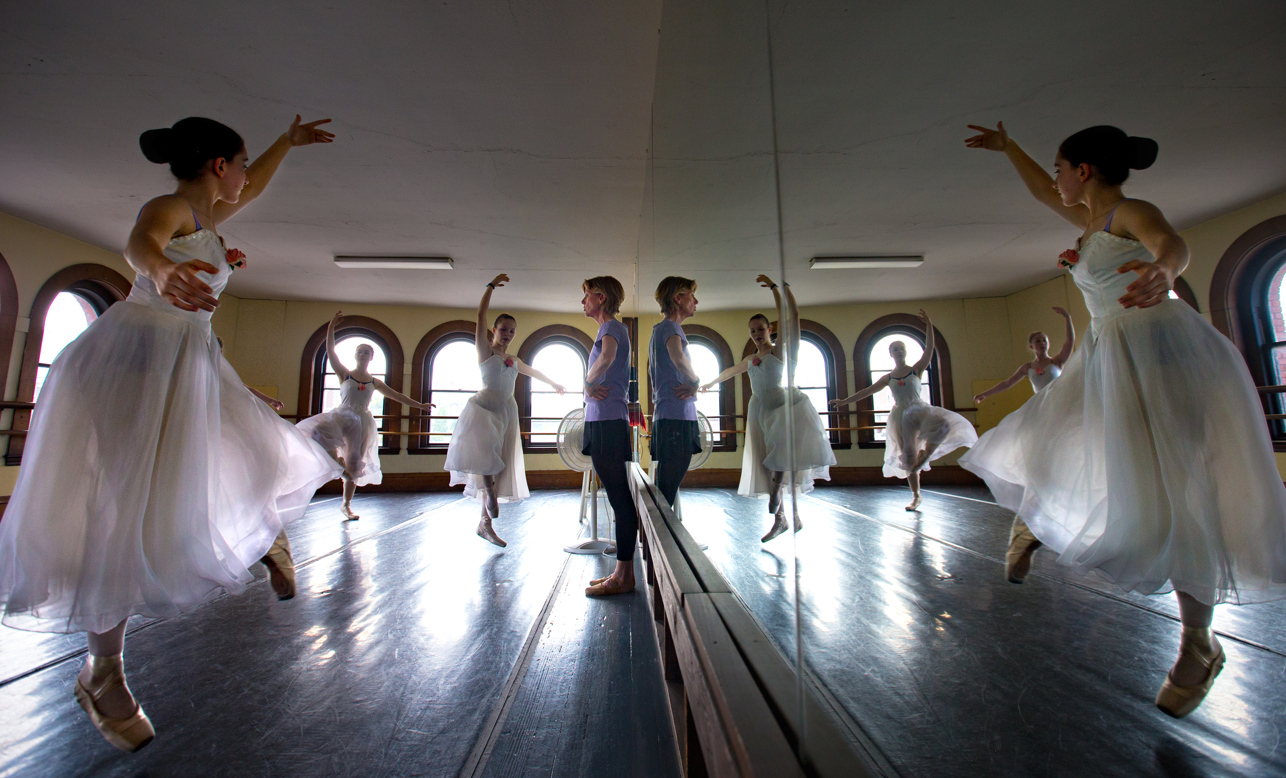 BANGOR, MAINE -- 05/23/2016 -- Maureen Robinson (center) watches some of her ballet students practice an en pointe routine at Robinson Ballet in Bangor on Monday. Maureen and her husband, Keith Robinson, have stepped down from their positions as co-artistic directors of Robinson Ballet in Bangor. For the first time since the company's inception in 1977, there will not be a Robinson at the helm. (Micky Bedell   BDN)