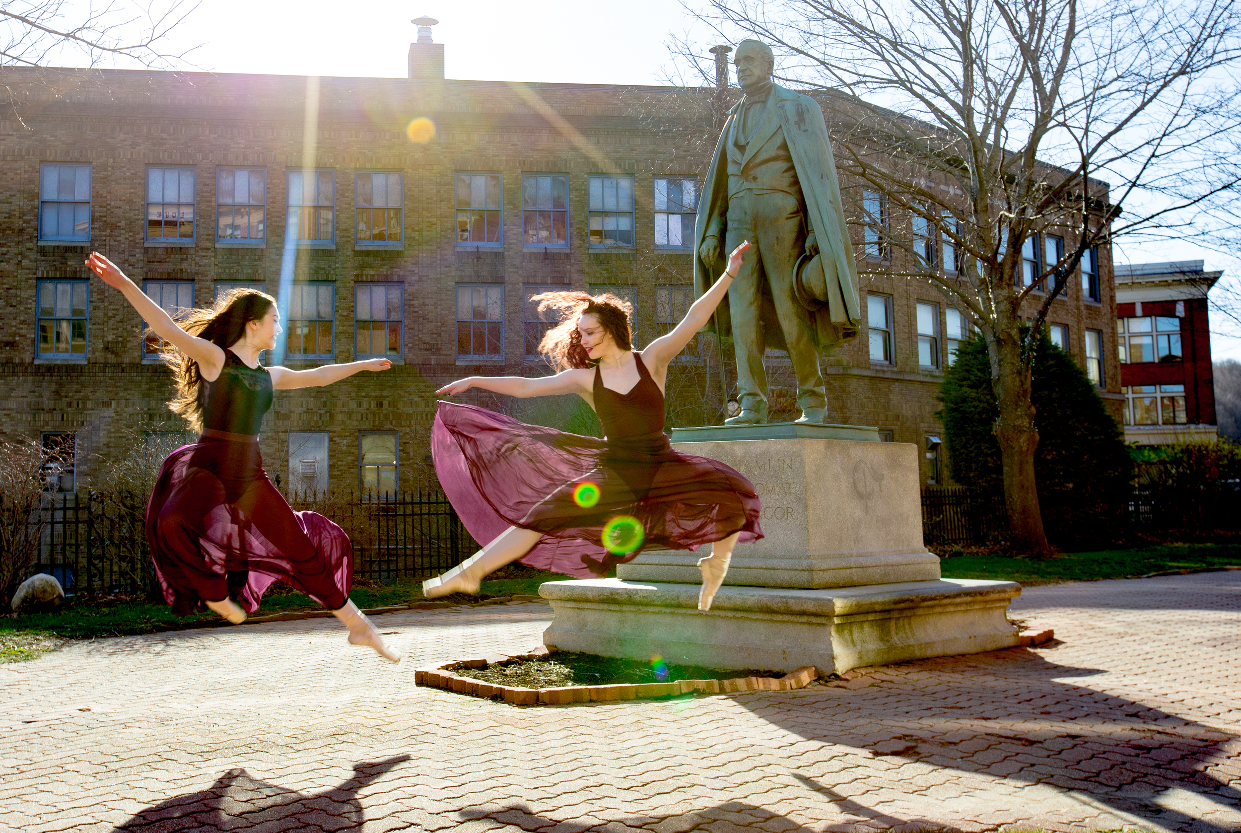 """BANGOR, MAINE -- 04/20/2016 -- Bangor Ballet students Kelsie Washington (right) and Catherine Ahola goof around after class on Wednesday in the Norumbega Parkway in Bangor. """"It's just such a nice day,"""" Washington said. """"Just feel the wind."""" (Micky Bedell   BDN)"""
