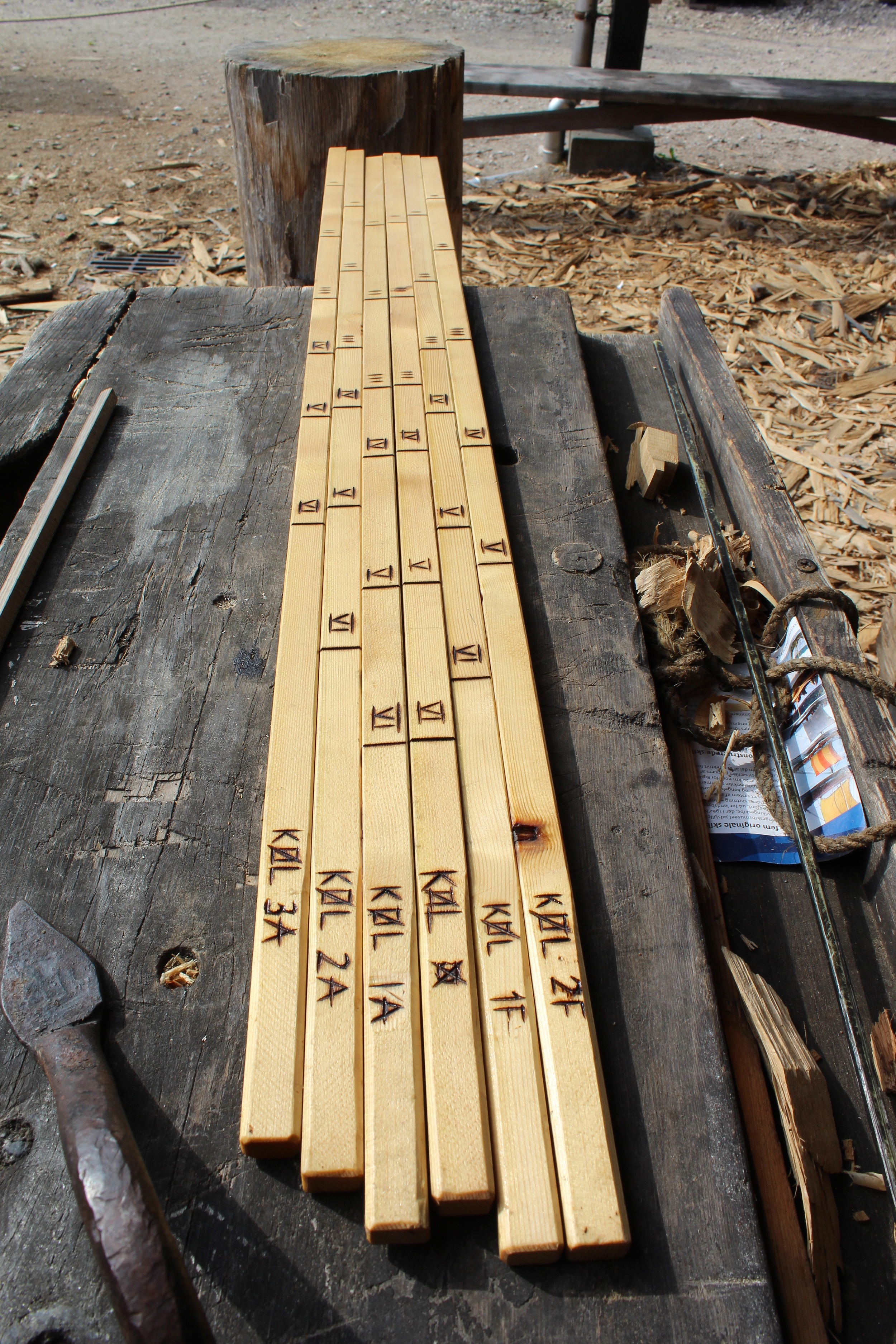 Tic-sticks for planking a Viking ship with markings for angles in Roman numerical