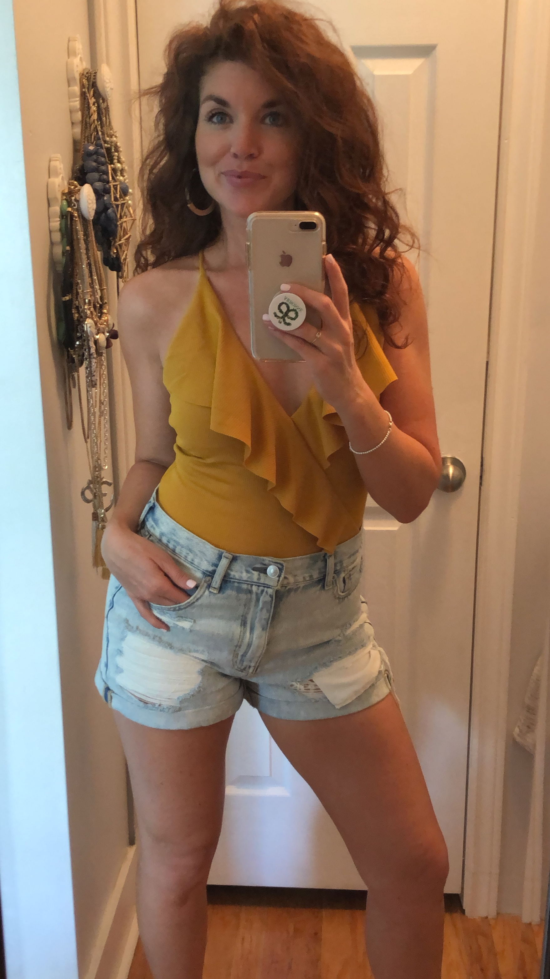 Wearing a bathing suit as a body suits is my new favourite way to dress and in my opinion, will always cut the mustard. Love this sexy casual look. Shorts:  American Eagle  Bathing Suit:  Cupshe  Earrings:  Aldo