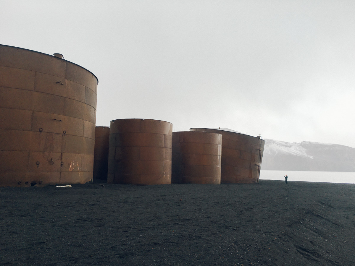 Massive metal barrels that at one time were used to store oil produced from whale fat