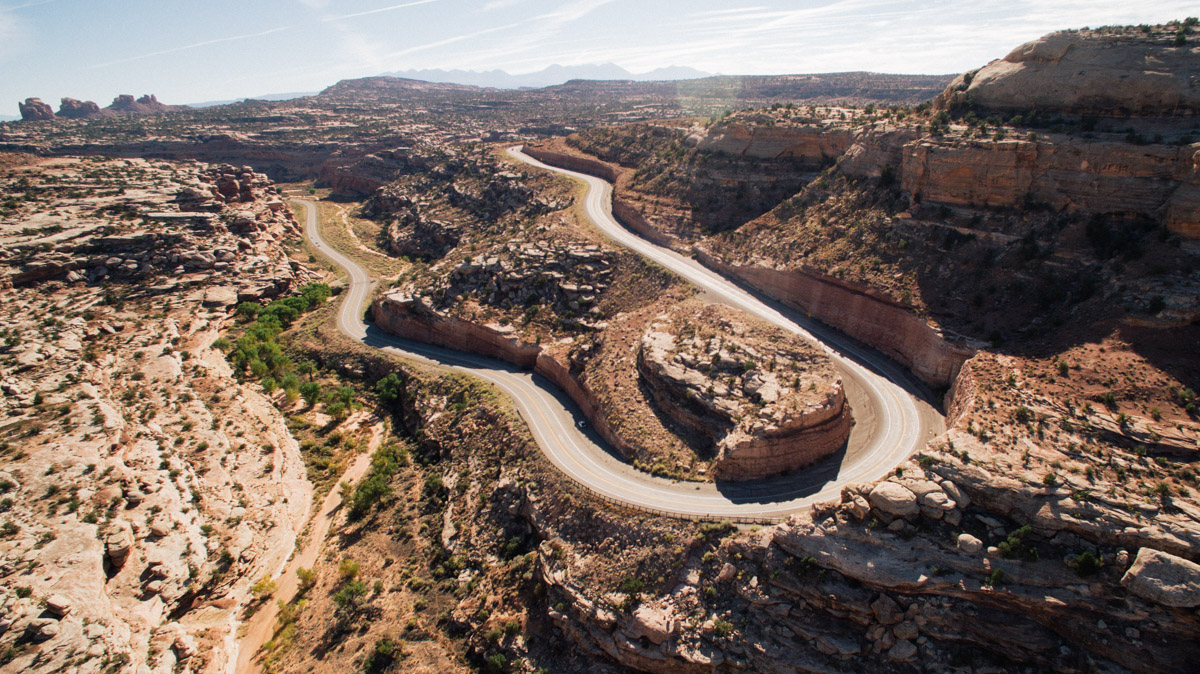 A turn on the road leaving Dead Horse point State Park resembles the Colorado River bend at Dead Horse, captured by Furby the Drone.