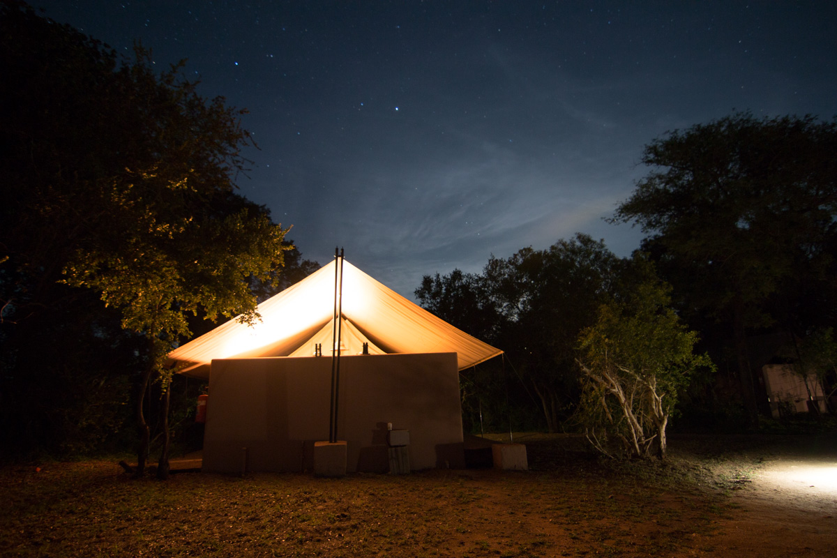 Rear view of our safari tent at night. The moon and stars would shine in so bright I almost had to wear an eyeshade to get to sleep at night. Also through the thin tent walls we could hear an orchestra of the bugs and frogs. Since our camp had no fences separating it from the surrounding reserve we had to be escorted to and from our tent each night so that we didn't have a surprise encounter with an aggressive buffalo or other wild animal.