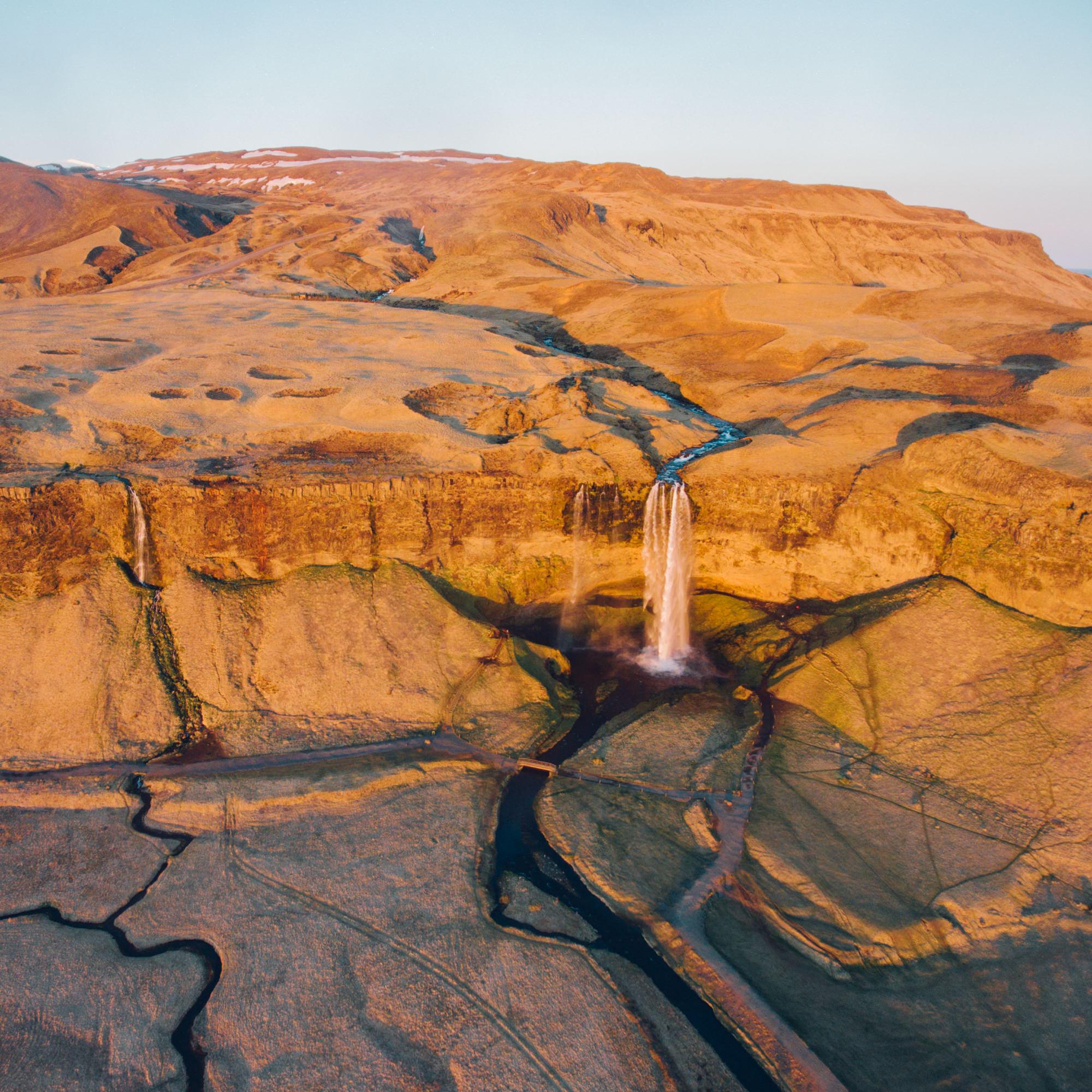 wrenee-iceland-part-1-31--seljalandsfoss-sunset-waterfall-drone.jpg