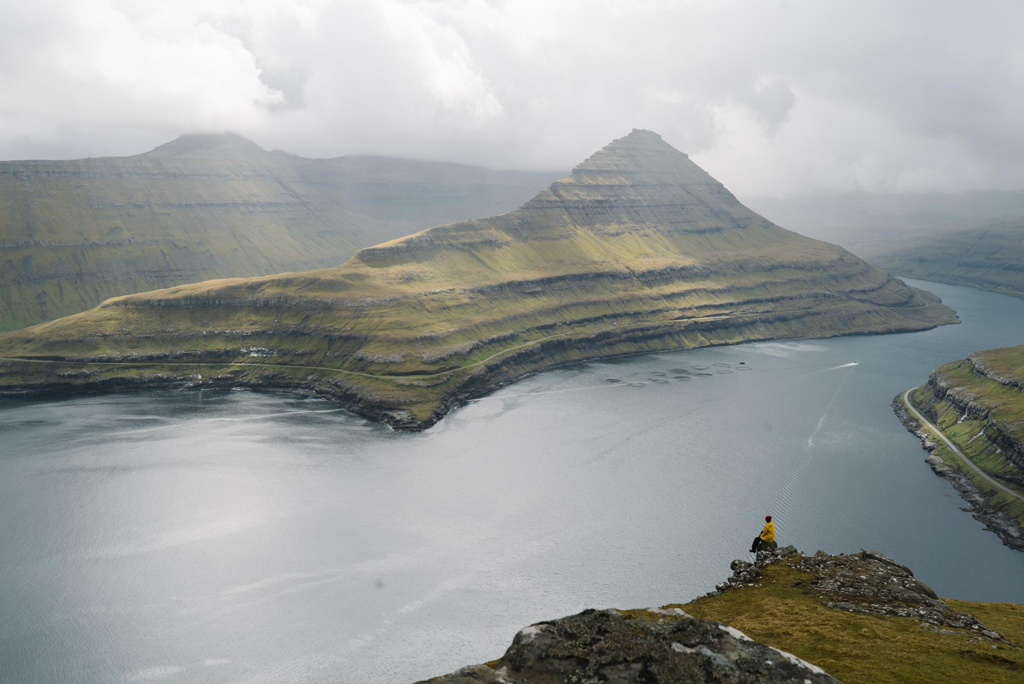 Clockwise from top left: standing looking back at Gjov, Old town Torshavn, taking in the view of Gasadalur Village, fjords at Gjógv, sister Noele enjoys some tea