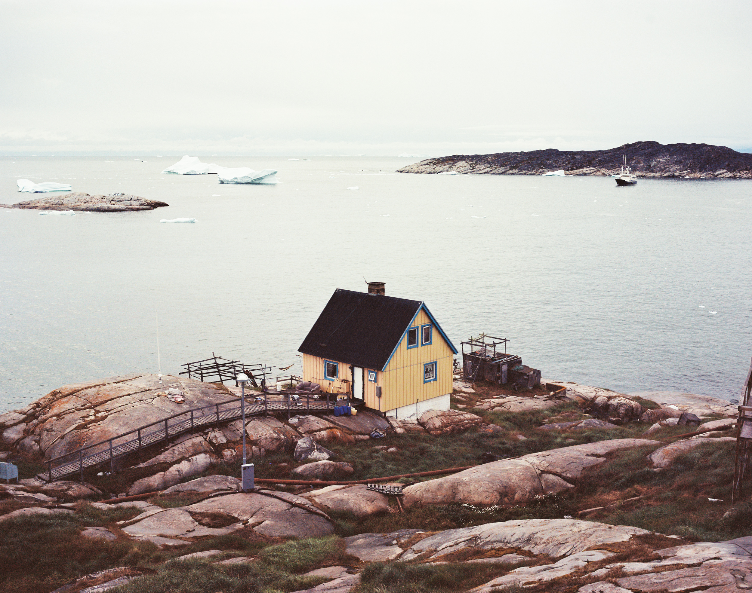 "A house overlooks Disko Bay on the edge of ""downtown"" Ilulissat. Photo shot on medium format film."