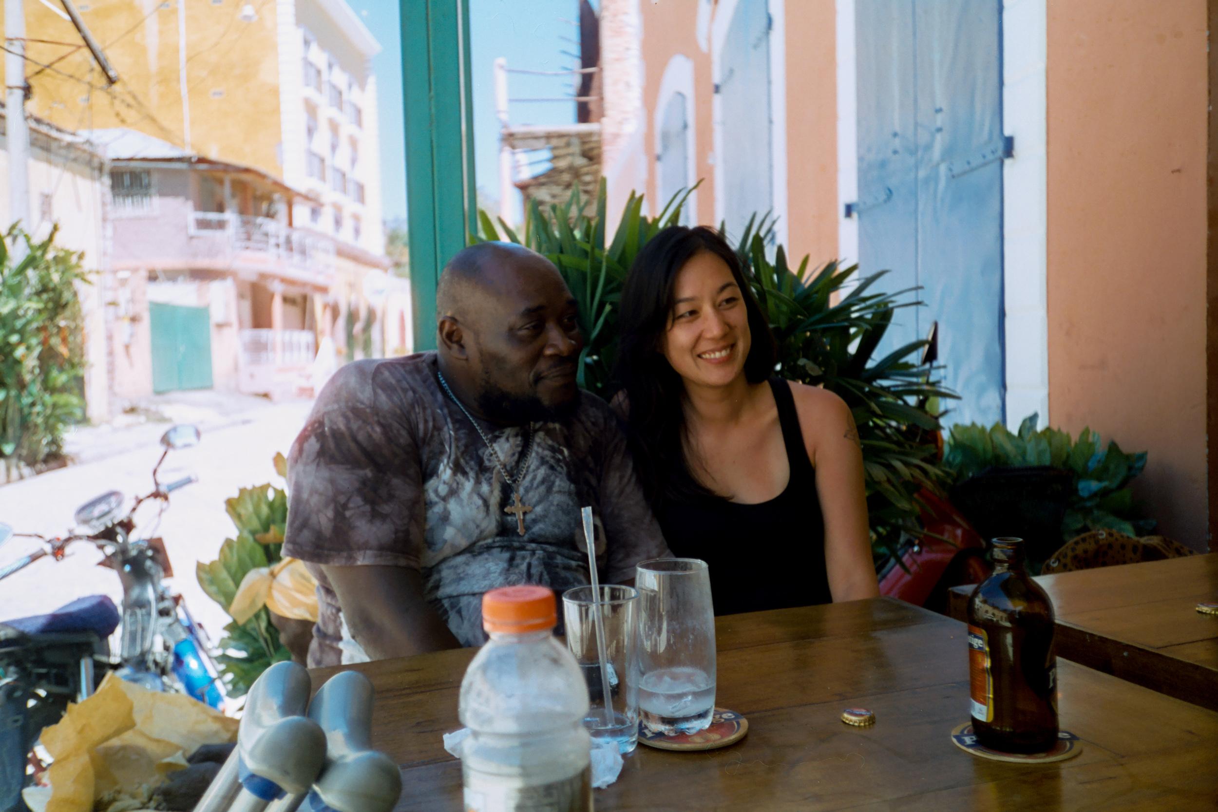 Jakson and Jenny at a cafe in Jacmel