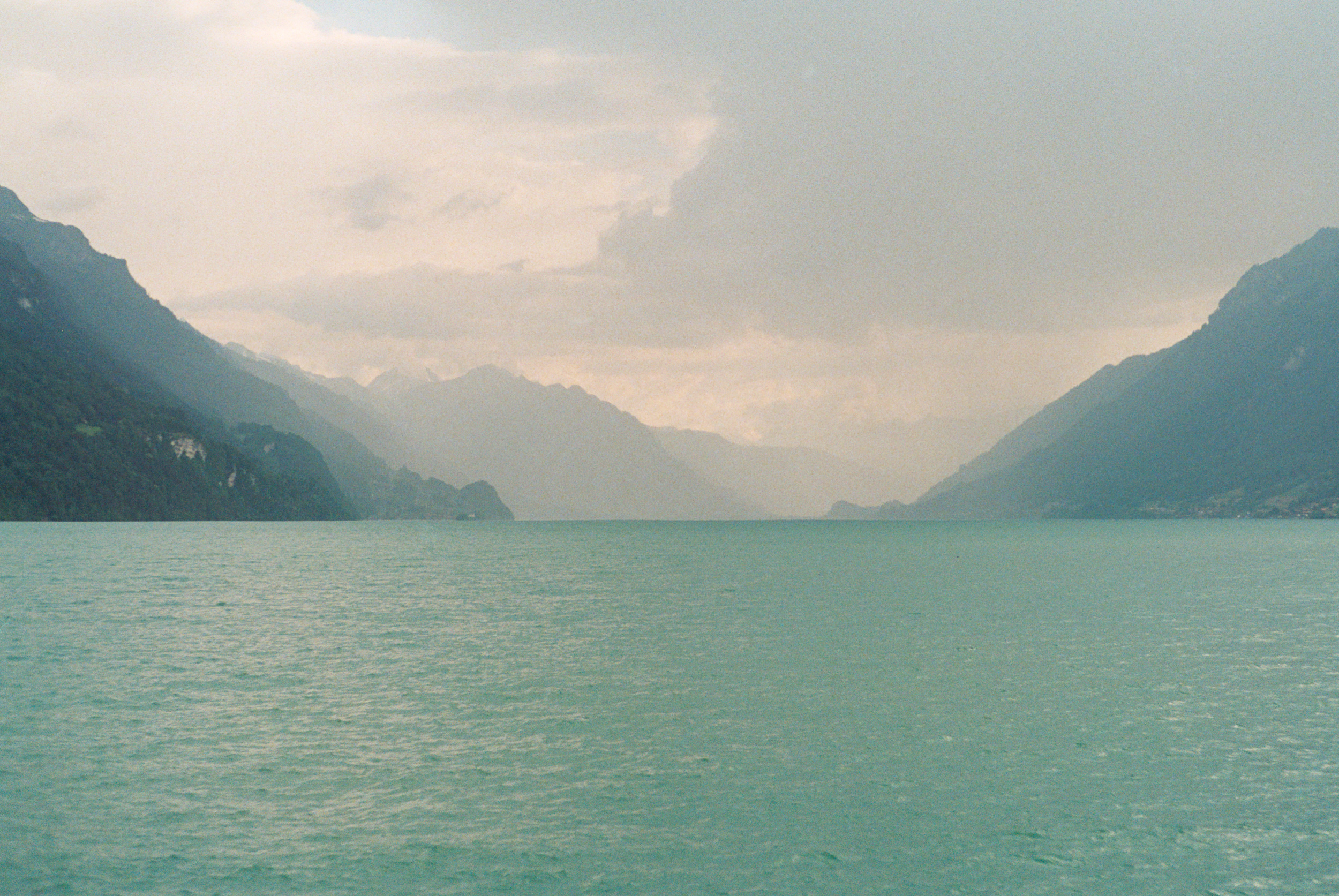 Whizzing by glacier blue lakes, seen from my train window between Lucerne and Interlaken. HEAVEN!