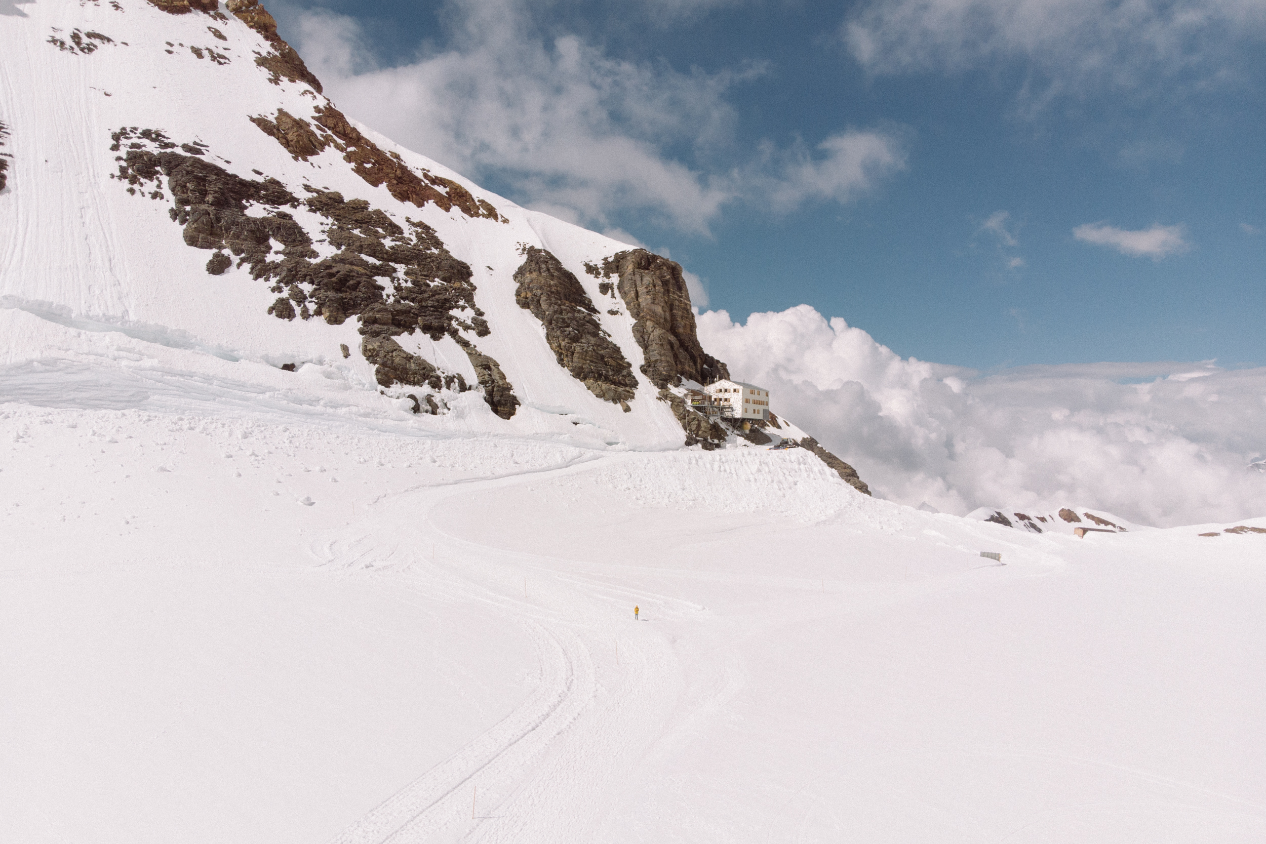 Drone photo looking back at the Mönchsjoch Hut. The speck in the middle of the frame is me.