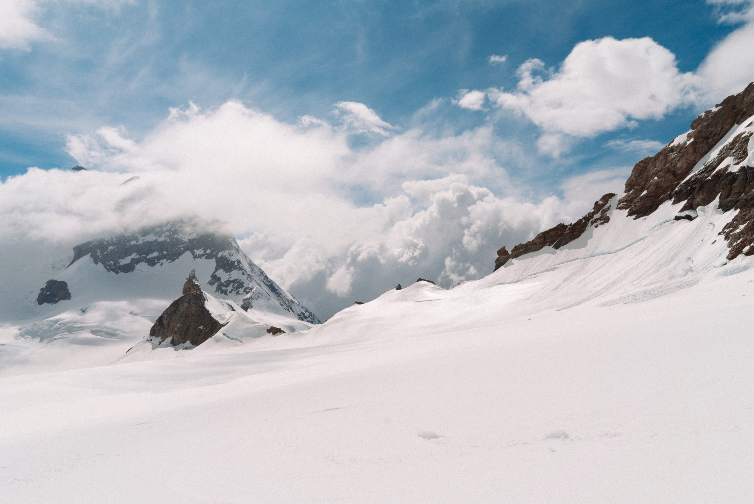 The view of the Sphinx Observatory and a cloudy Jungfrau peak on my walk back from Mönchsjoch Hut.