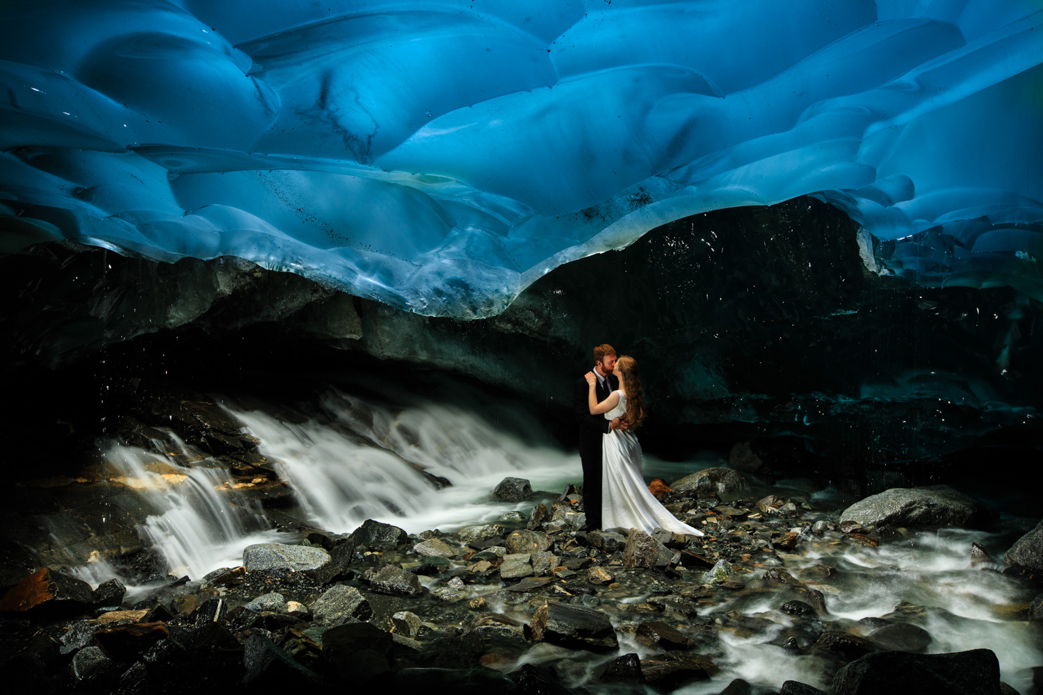 Bride and Groom Inside Ice Cave in Alaska