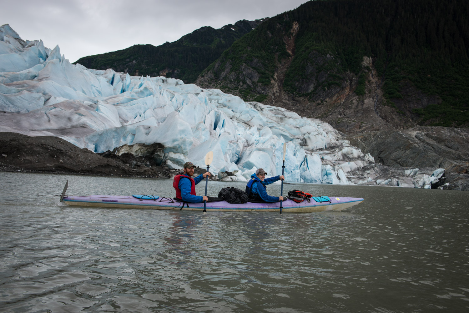 Once at the glacier, we had to beach the kayaks and hike up the side of the mountain.  This glacier is melting so fast it is starting to show signs of a forest that was once underneath it.  Scientists believe the wood under the glacier is over 10,000 years old.