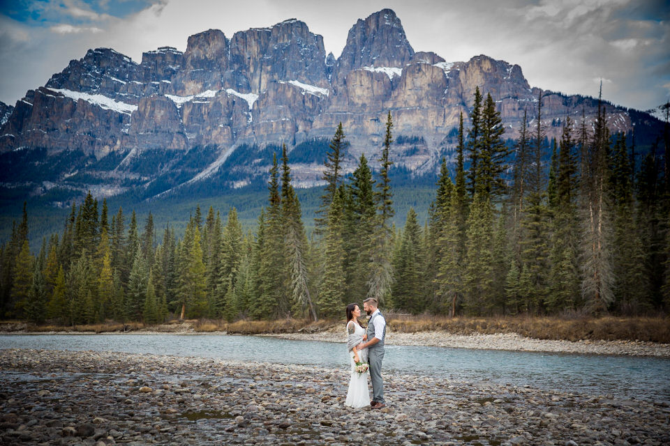 Storm Mountain Lodge Wedding. Wedding photos of Castle Mountain in background Banff National Park.