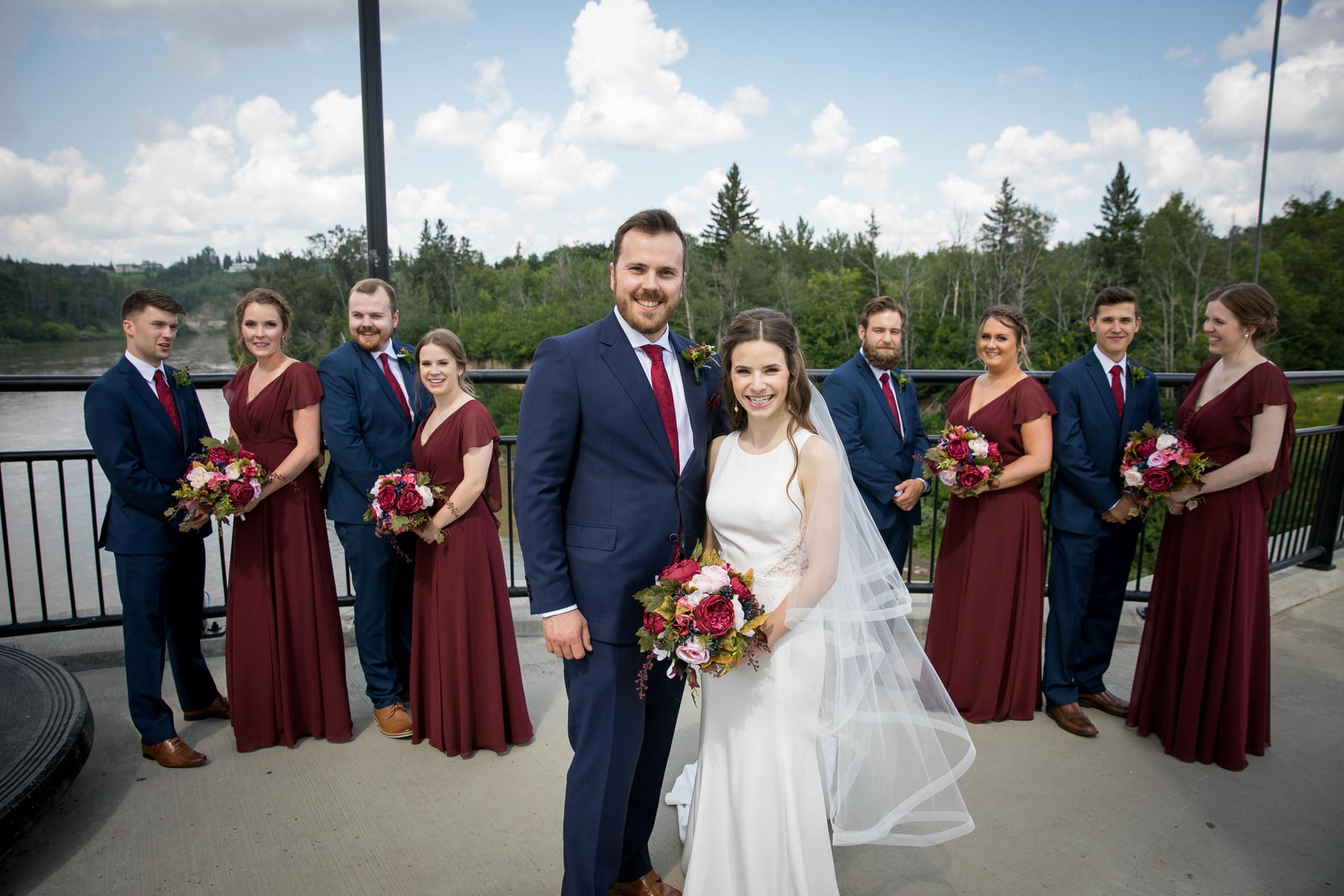 Bride and Groom pose for photo Edmonton Wedding Photographer
