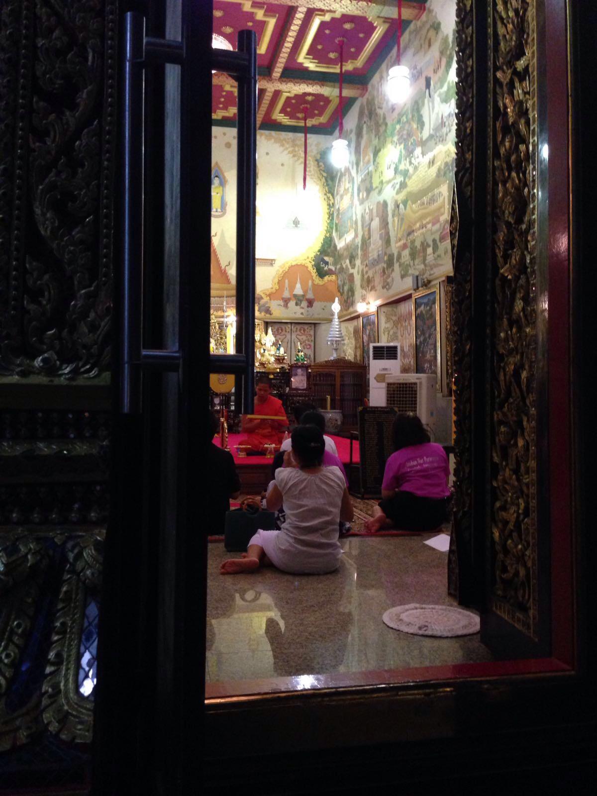 Pray in a Buddah temple