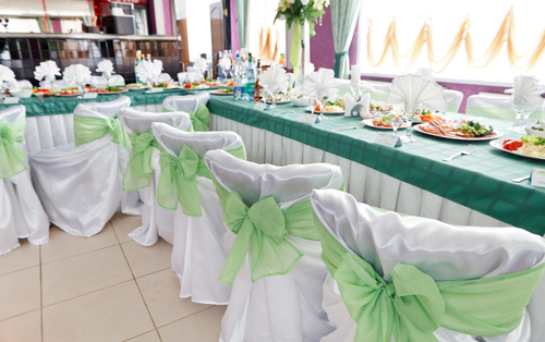White satin tieback chair cover with mint green organza sash