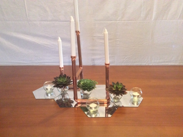 4 arm copper candelabra with fishbowl tealights and succulents on hexagonal mirror base