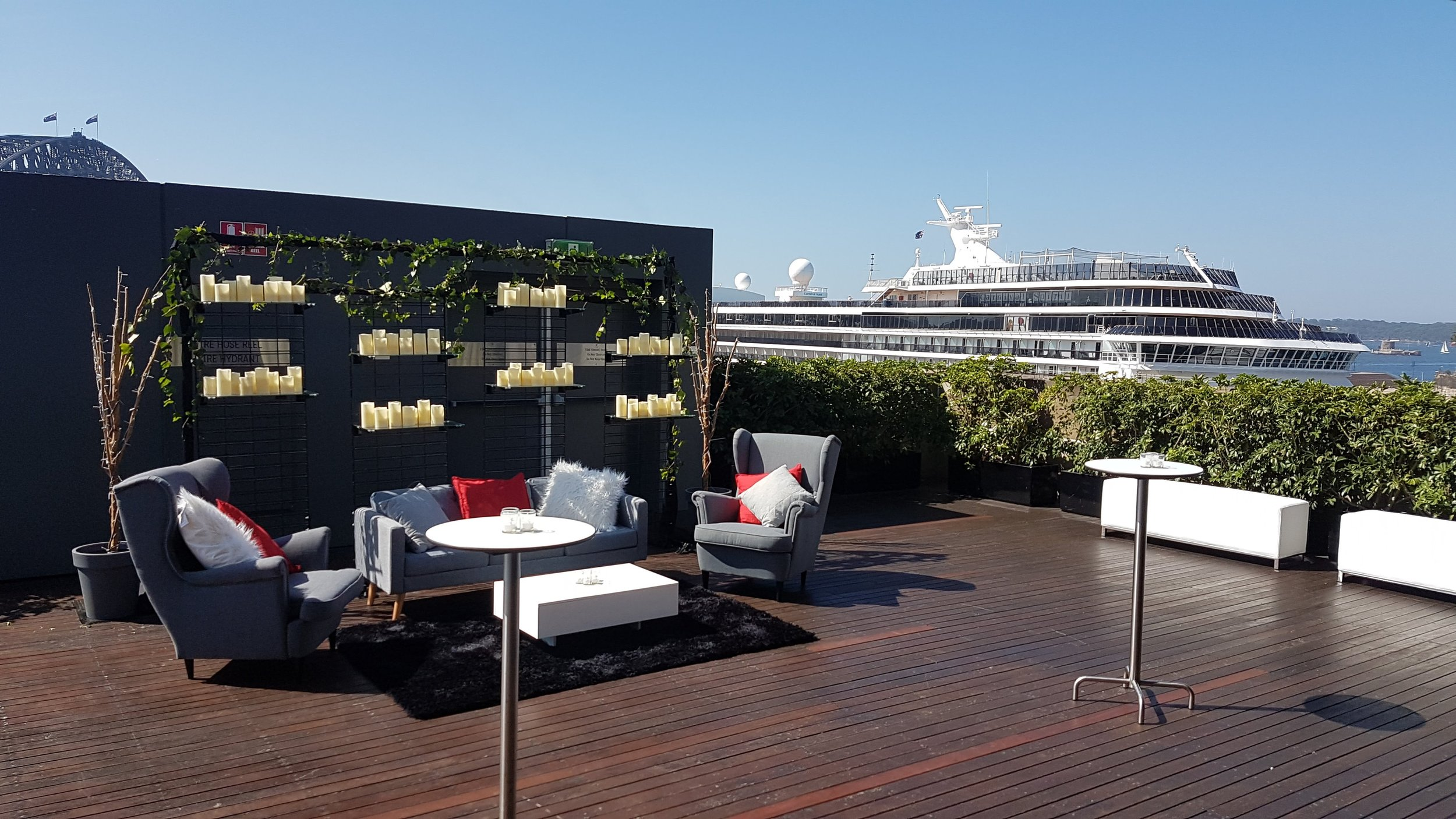 Modern and CONTEMPORARY lounge setting at the amazing mca sydney venue - harbourside room - pop up screen with ivy and candles to hide the fire exit