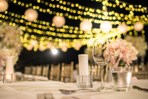 outdoor reception with warm amber fairylights