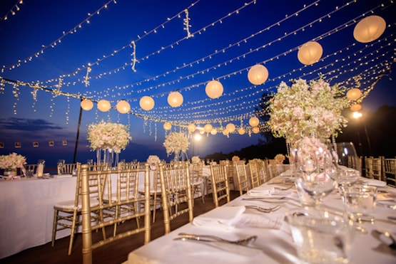 outdoor reception with fairy lights and lanterns