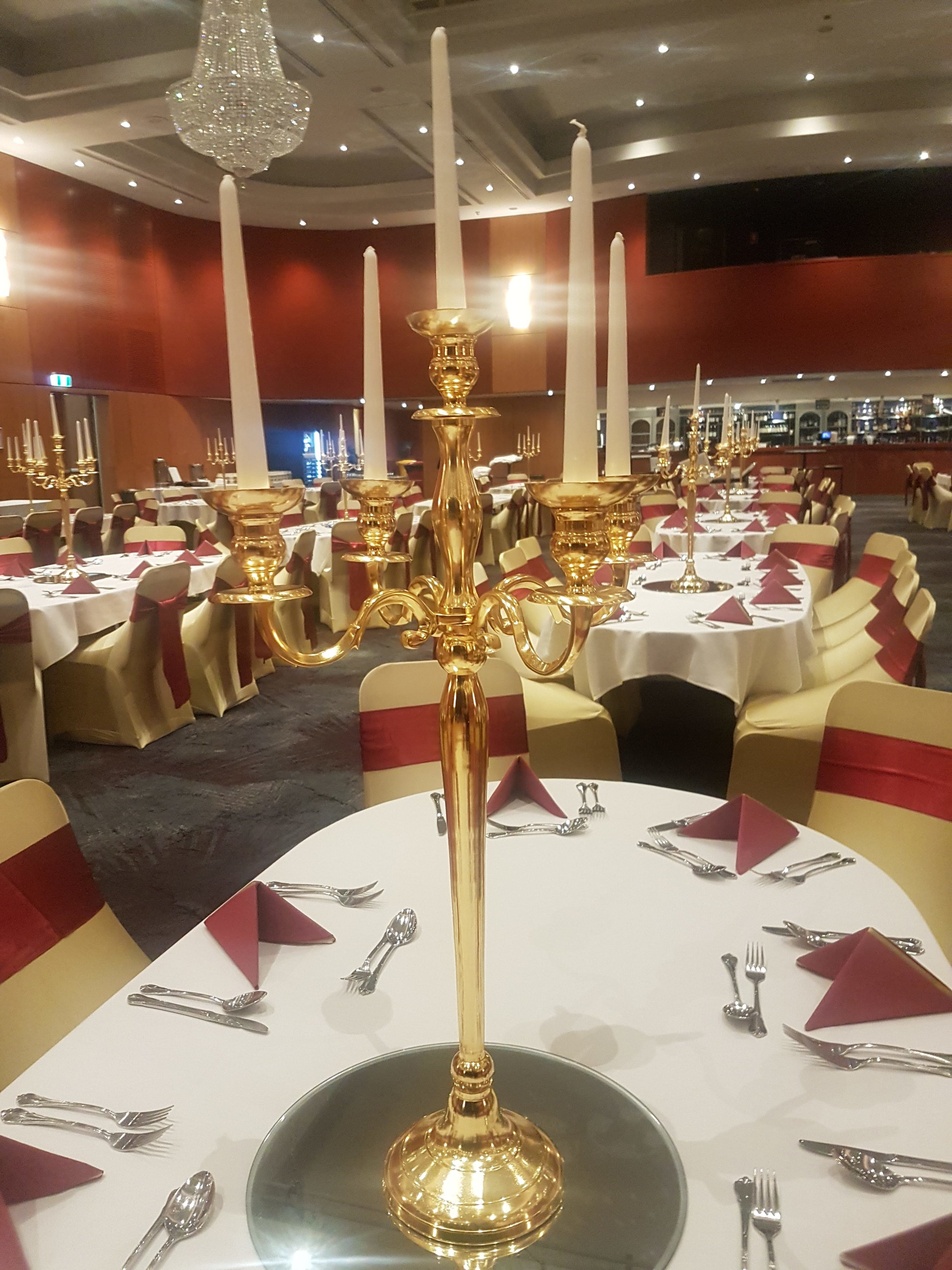Gold Candelabra with tapered dinner candles on round mirror base