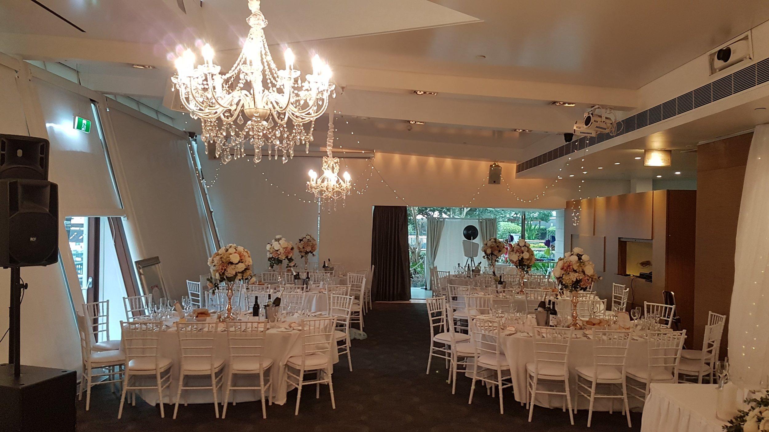 12 arm crystal chandelier with 6arm chandelier and fairylights @ L'Aqua Terrace room sydney  http://docksidegroup.com.au/venues/laqua