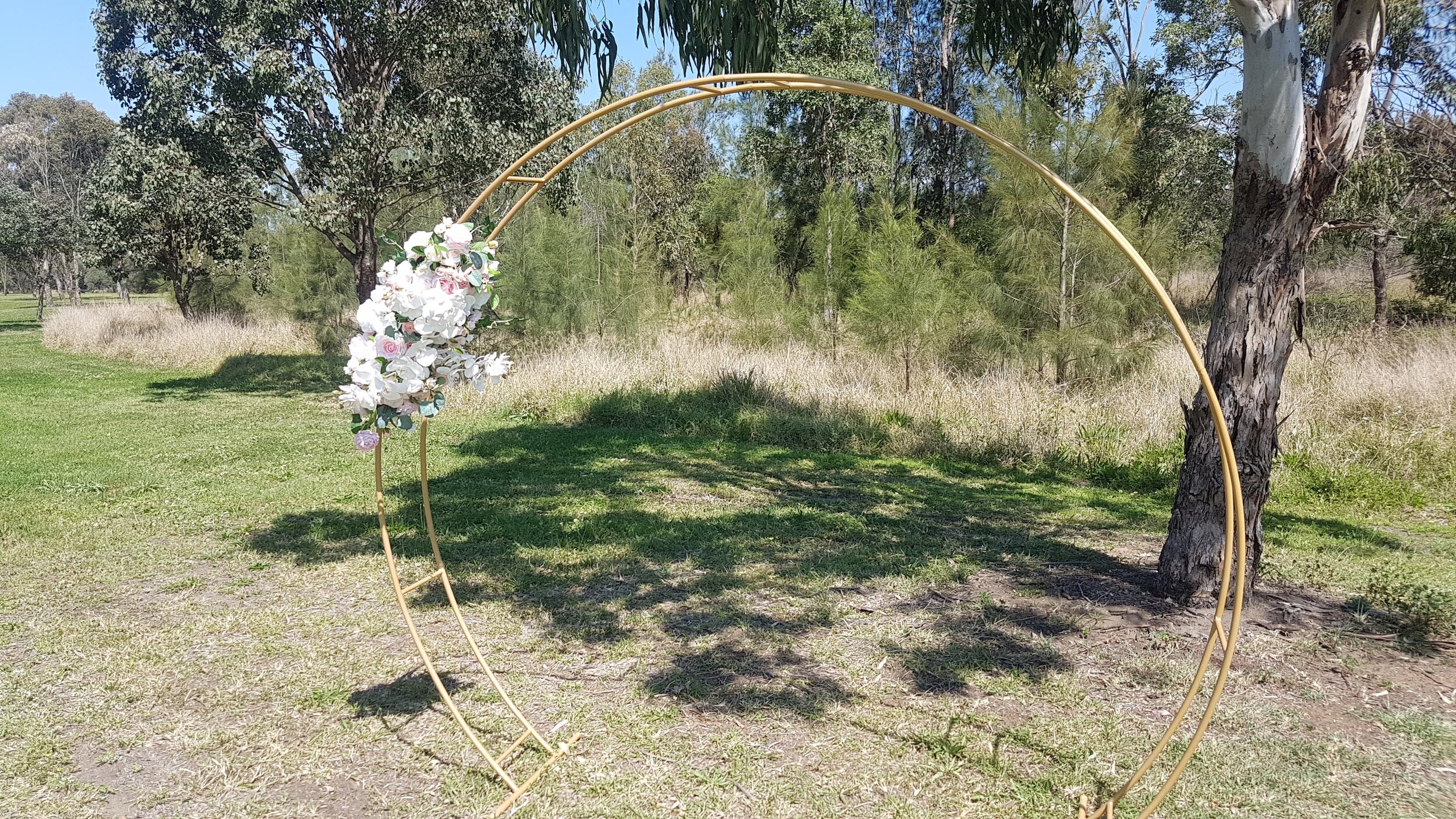 Gold Tubular Moon Arch with Silk Floral for Hire