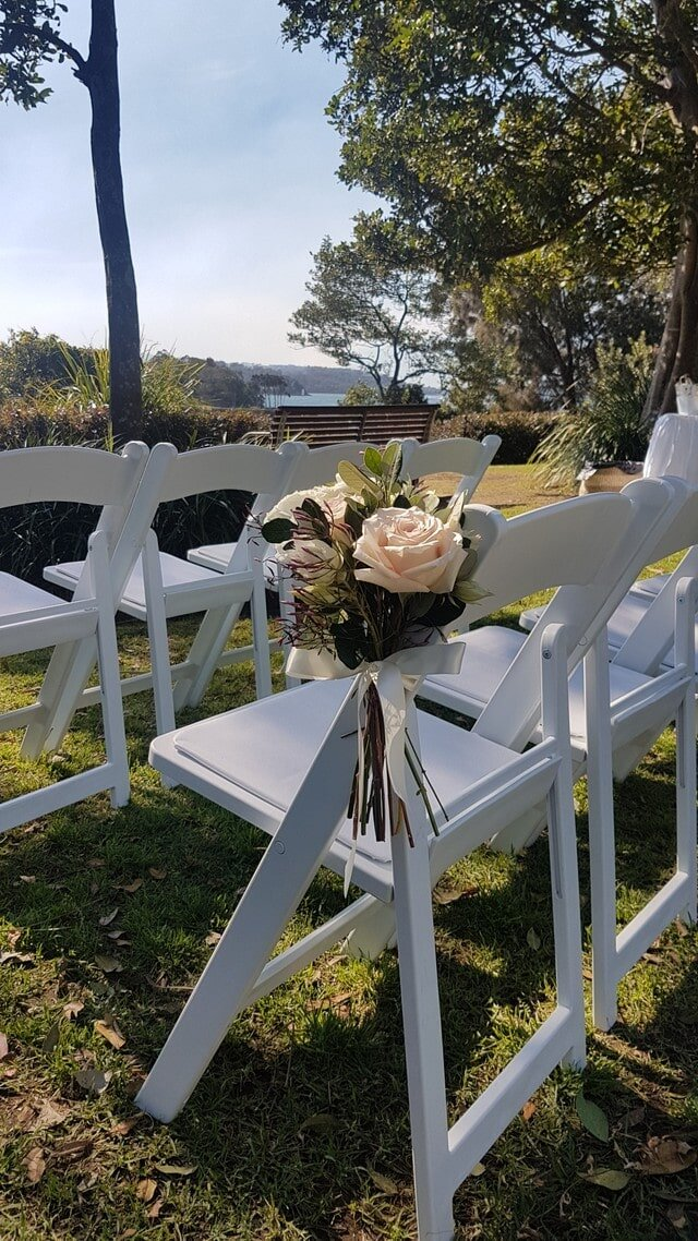 Mckell Park darling point Wedding ceremony floral pew end on white folding chair