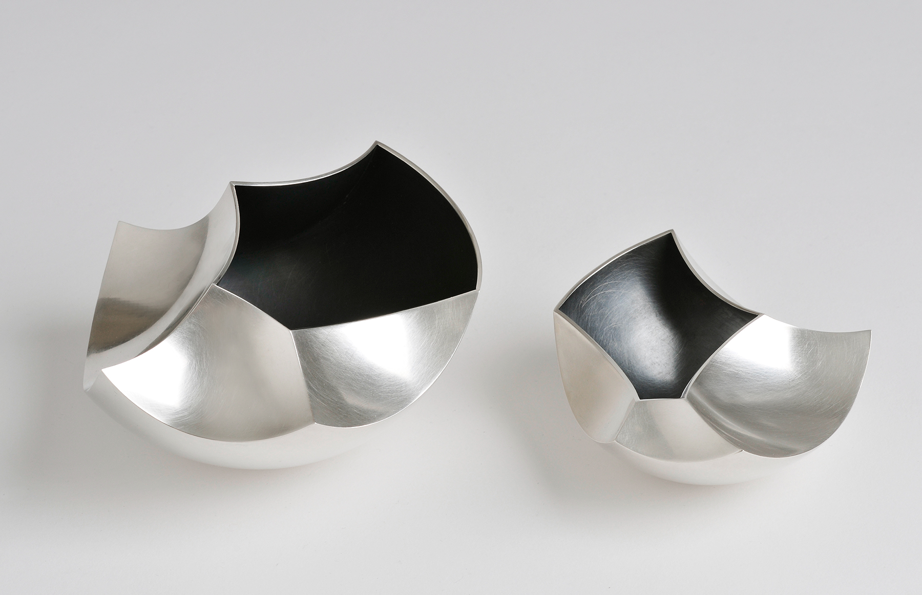 A pair of 'Introverted Bowls' in sterling silver