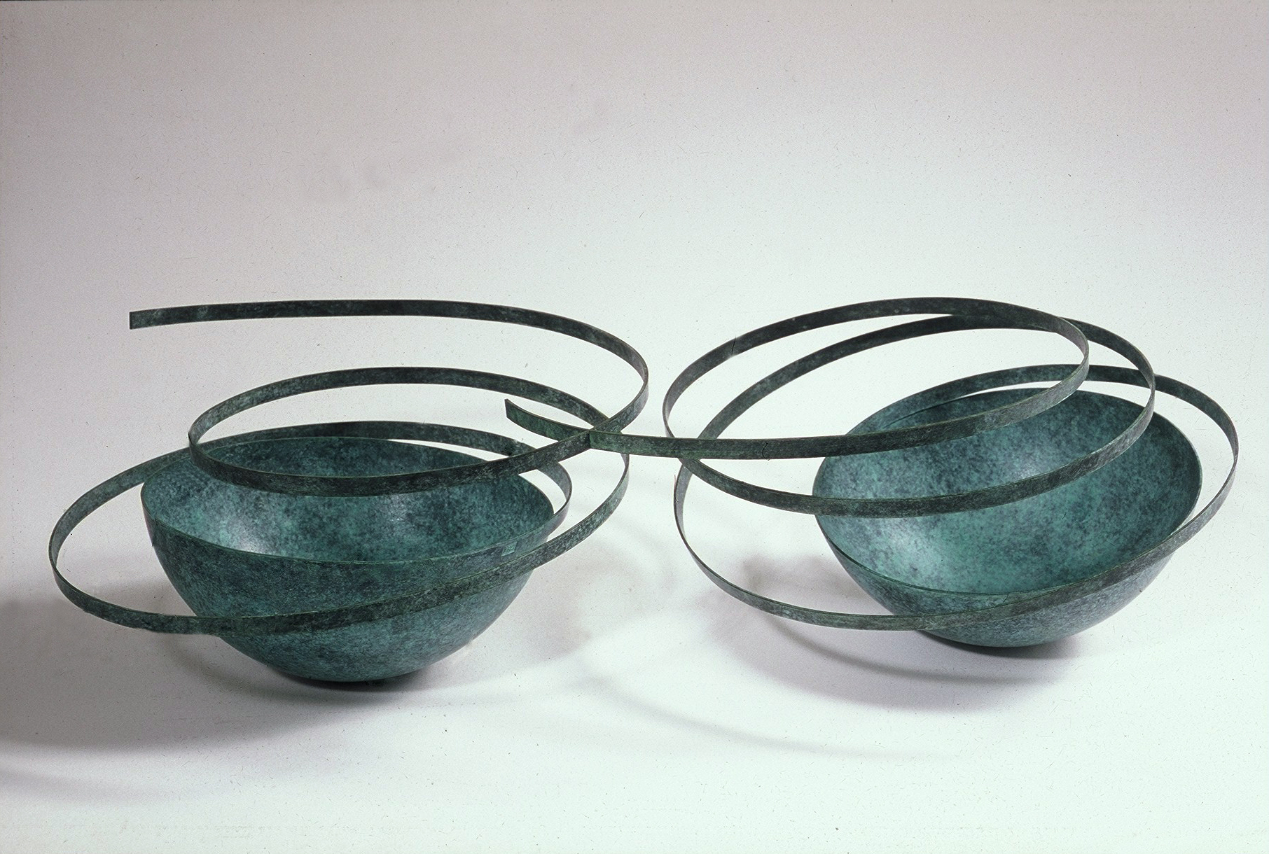 'Connected Bowls' in verdigris copper