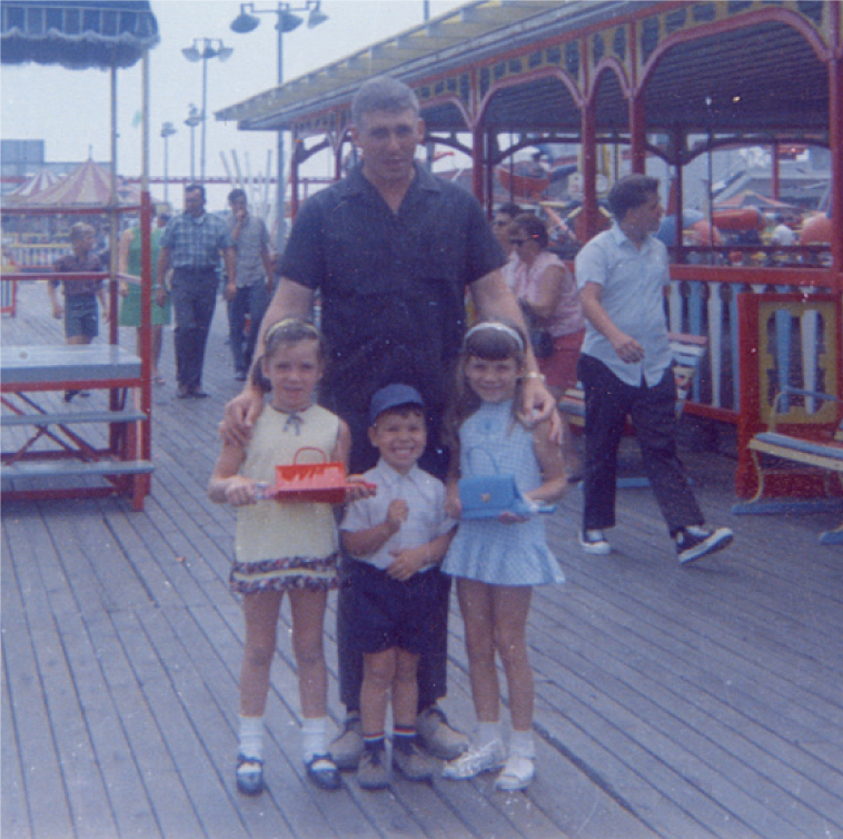 Dawn with her father, brother and sister at the New Jersey boardwalk before her dad left for Viet Nam.