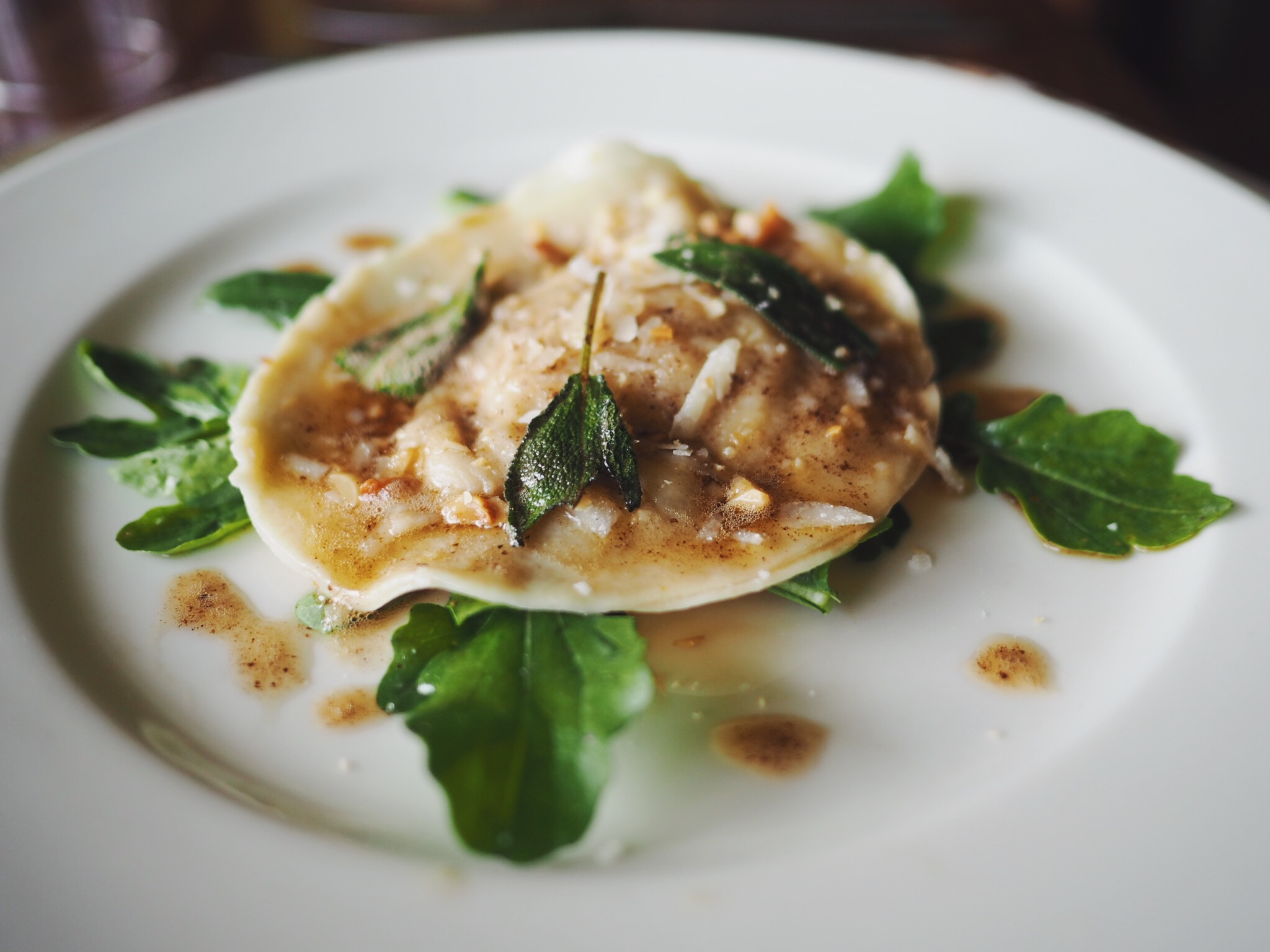 Butternut Raviolo with sage brown butter & rocket