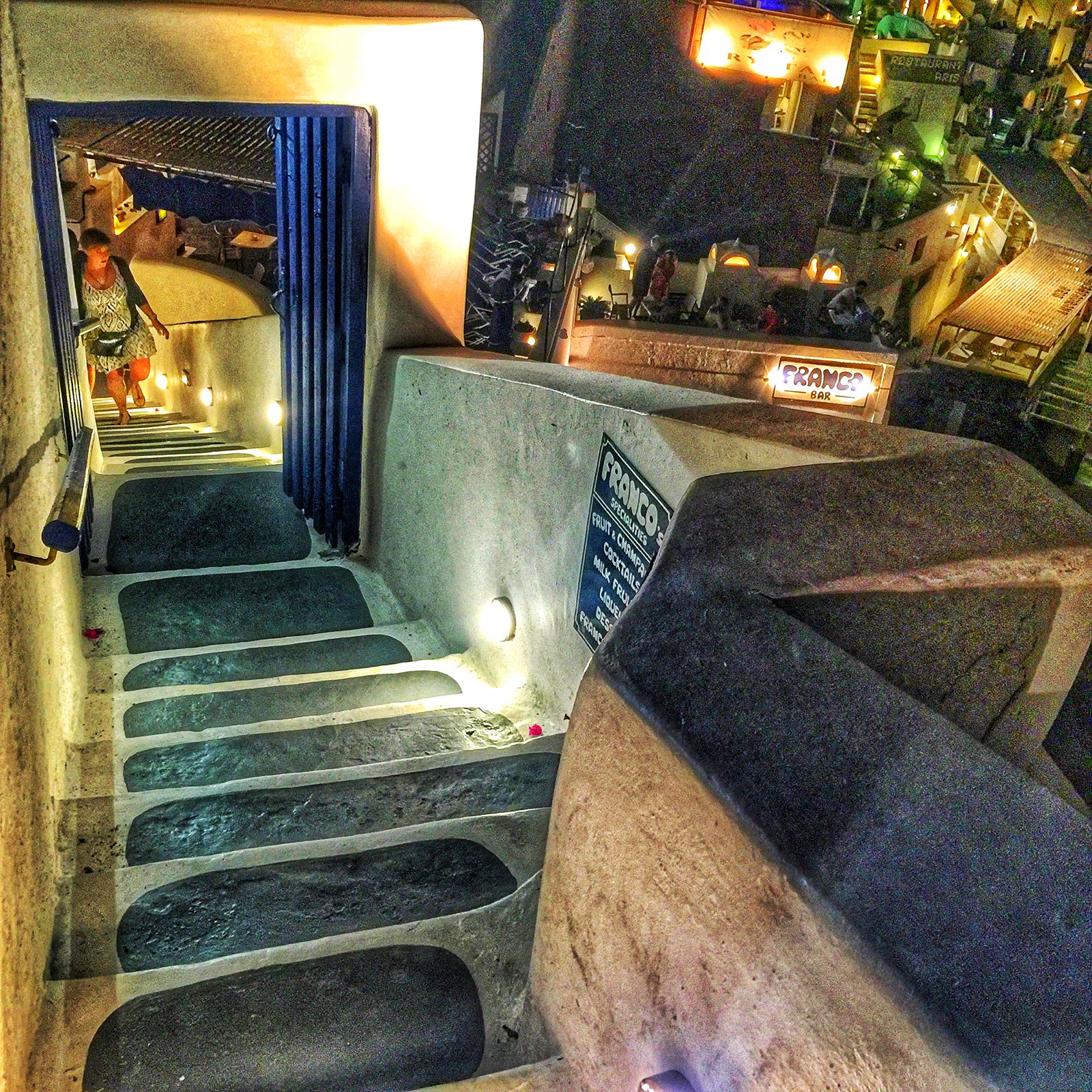 The restaurants are either up a staircase or down a stair case hanging over the caldera. No matter where you eat if you're on the last street in the town the views will be spectacular.