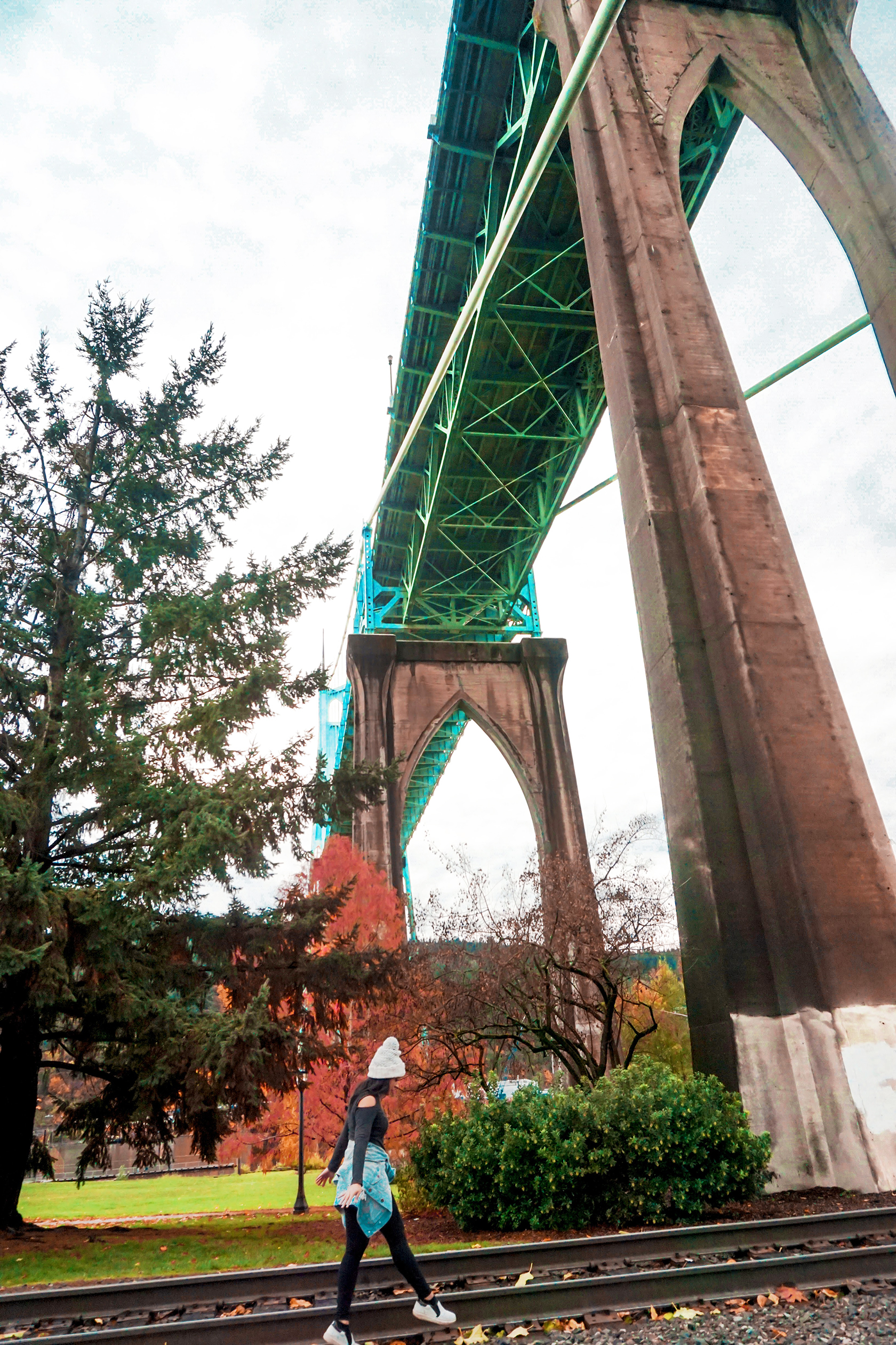 Walk along the tracks and under the bridge at Cathedral Park, located all the way North in Portland, just across the river from Vancouver, Washington.